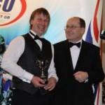 Mark receives winners trophy